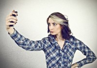 girl-taking-self-photo-with-smart-phone--hppd