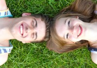 young-happy-couple-lying-in-grass--juergen-faelchle